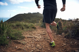 Trail Running Athlete Exercising for Fitness and Health Outdoors on Mountain Pathway Posters by  warrengoldswain