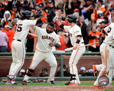 Brandon Crawford, Pablo Sandoval, & Buster Posey celebrate winning Game 3 of the 2014 National Leag Photo