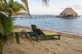Placencia, Belize. Lounge Chairs on Groomed Sandy Beach Photographic Print by Trish Drury