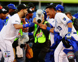 Eric Hosmer & Salvador Perez celebrate winning Game 4 of the 2014 American League Championship Seri Photo