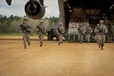 U.S. Aeromedical Evacuation Airmen Exit a C-17 Globemaster Iii Photographic Print
