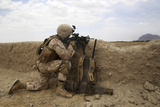 U.S. Marine Provides Security from Behind a Mud Wall Photographic Print