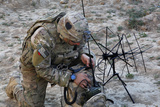 U.S. Army Specialist Sets Up Radio Communications Photographic Print