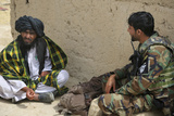 A Commando from 3rd Special Operations Kandak Speaks with a Local Villager Photographic Print