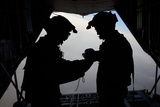 U.S. Air Force Loadmasters Fold the American Flag Aboard an Hc-130 Hercules Photographic Print