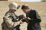 U.S. Marine Utilizes a Biometric Enrollment and Screening Device Photographic Print