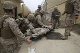 U.S. Marines and Navy Corpsmen Treat a Simulated Casualty Photographic Print