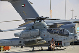 U.S. Marine Takes a Break Sitting on an Ah-1Z Cobra Attack Helicopter Photographic Print