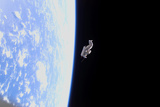 Suitsat in Orbit around Planet Earth Photographic Print