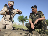 U.S. Marine Learns the Details of a Rocket Propelled Grenade from a Ukrainian Marine Photographic Print