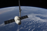 The Spacex Dragon Cargo Craft Prior to Being Released by the Canadarm2 Robotic Arm Photographic Print