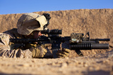 U.S. Marine Scans for Threats During a Firefight in Afghanistan Photographic Print