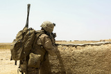 U.S. Marine Takes Cover Behind a Wall During a Patrol in Afghanistan Photographic Print