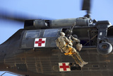 Royal Australian Air Force Aircraftman Is Hoisted onto a Uh-60 Black Hawk Photographic Print