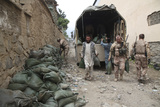 Czech Soldiers and Afghan Uniform Police Officers Unload Sandbags from a Truck Photographic Print