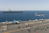 An Mh-60R Sea Hawk Helicopter Launches from USS Harry S. Truman Stampa fotografica