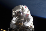 Astronaut Participating in a Spacewalk Photographic Print