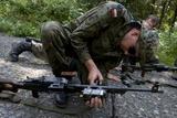 A Polish Soldier Attaches a Training Device to His Pkm Machine Gun Photographic Print