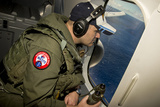Naval Aircrewman Searches Out the Window of a P-8A Poseidon Photographic Print