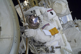 Astronaut Participates in a Spacewalk Outside the International Space Station Photographic Print