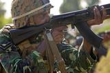 Maldivian Marine Fires an Ak-47 Service Rifle Photographic Print