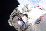 Astronaut During a Spacewalk with Earth in Background Photographic Print