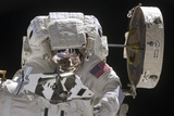 Astronaut Working on Part of the International Space Station Photographic Print