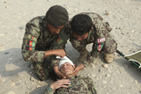 Afghan National Army Soldiers Put a Head Bandage on a Fellow Soldier Photographic Print