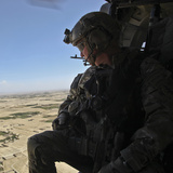 A U.S. Army Special Forces Soldier Looks Out from a Uh-60 Black Hawk Photographic Print