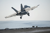 An F-A-18F Super Hornet Launches from the Flight Deck of USS Harry S. Truman Photographic Print
