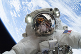Astronaut Participates in a Spacewalk Photographic Print