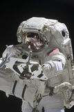 Astronaut Uses a Digital Still Camera During a Spacewalk Photographic Print