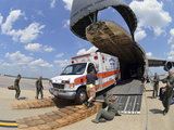 Airmen Load an Ambulance and Two Fire Trucks onto a C-5 Galaxy Photographic Print