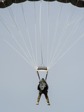 A U.S. Air Force Pararescueman Descends During Jump Training Photographic Print