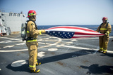 Firemen Fold the American Flag Aboard USS William P. Lawrence Photographic Print