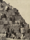 Several People Gathered at the Base of the Great Pyramid, Others Climbing Photographic Print