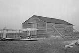 Front View of Glider in Front of the Camp Building at Kitty Photographic Print