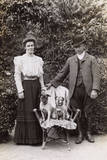 Edwardian Couple with Two Pug Dogs in a Garden Photographic Print