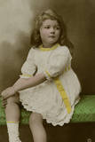 Little Girl in White Dress with Yellow Trimmings Photographic Print