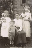 Family of Four with a Dog and a Doll in a Garden Photographic Print