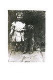 Little Girl with a Dog in a Garden Photographic Print
