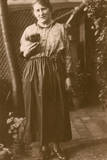 Woman and Puppy in a Garden Photographic Print