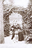 Woman with a Dog in a Garden Photographic Print