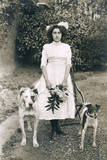 Young Woman with Two Dogs in a Garden Photographic Print