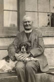 Vicar with a Spaniel Dog on a Bench Photographic Print