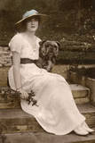 Gabrielle Ray, English Actress, with a Dog in a Garden Photographic Print