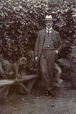 Man with a Bulldog in a Garden Photographic Print