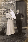 Girl and Boy with Baby and Spaniel Outside a House Photographic Print