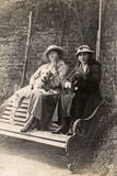 Two Women and their Dogs in a Garden Photographic Print