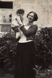 Woman with Pekingese Dog in a Garden Photographic Print